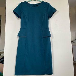 Deep teal blue women's stretch peplum dress